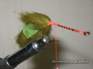 Tying a tail on the deer hair mouse fly