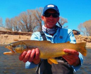charlie rock on the madison river with a bright brown