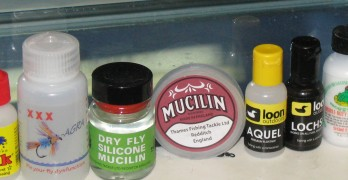 Umpqua bug flote, gherkes gink, fly-agra, liquid mucilin silicone, red can of mucilin, loon aquel, loon lochsa, frogs fanny, shimizake dry shake and dry magic floatants.