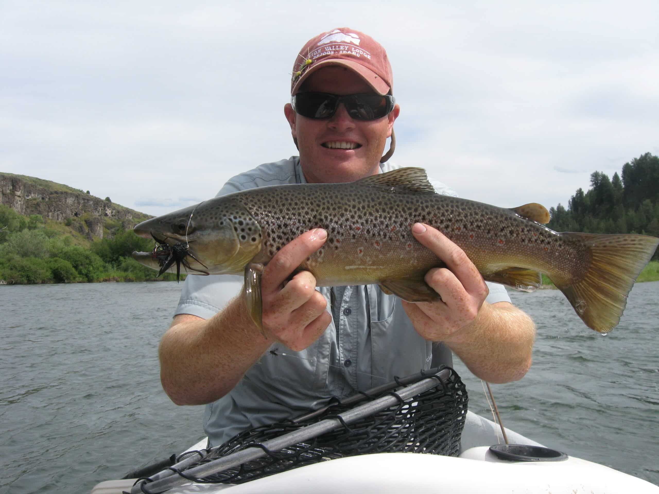 Dallin Owens hold a nice brown caught in the South Fork of the Snake River