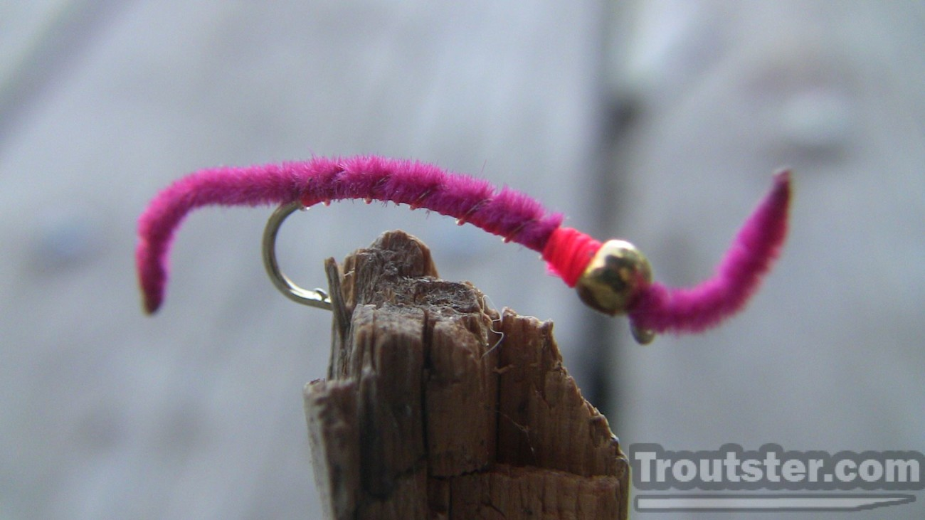 The San Juan worm fly tied with a brass bead.