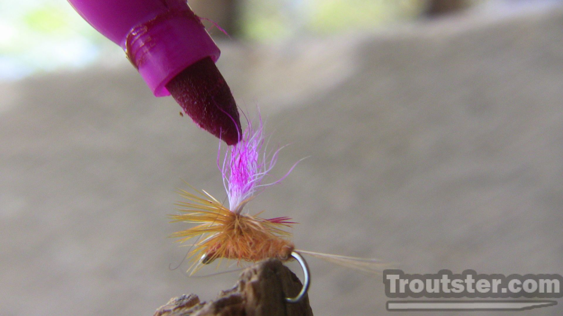 Coloring the parachute of a small dry fly can make it much more visible from a distance.
