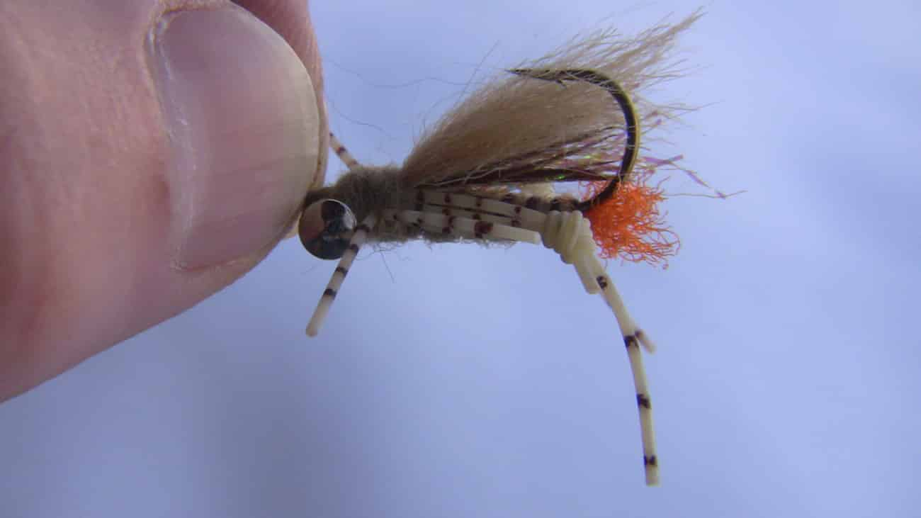 Tan colored weighted grasshopper fly pattern.