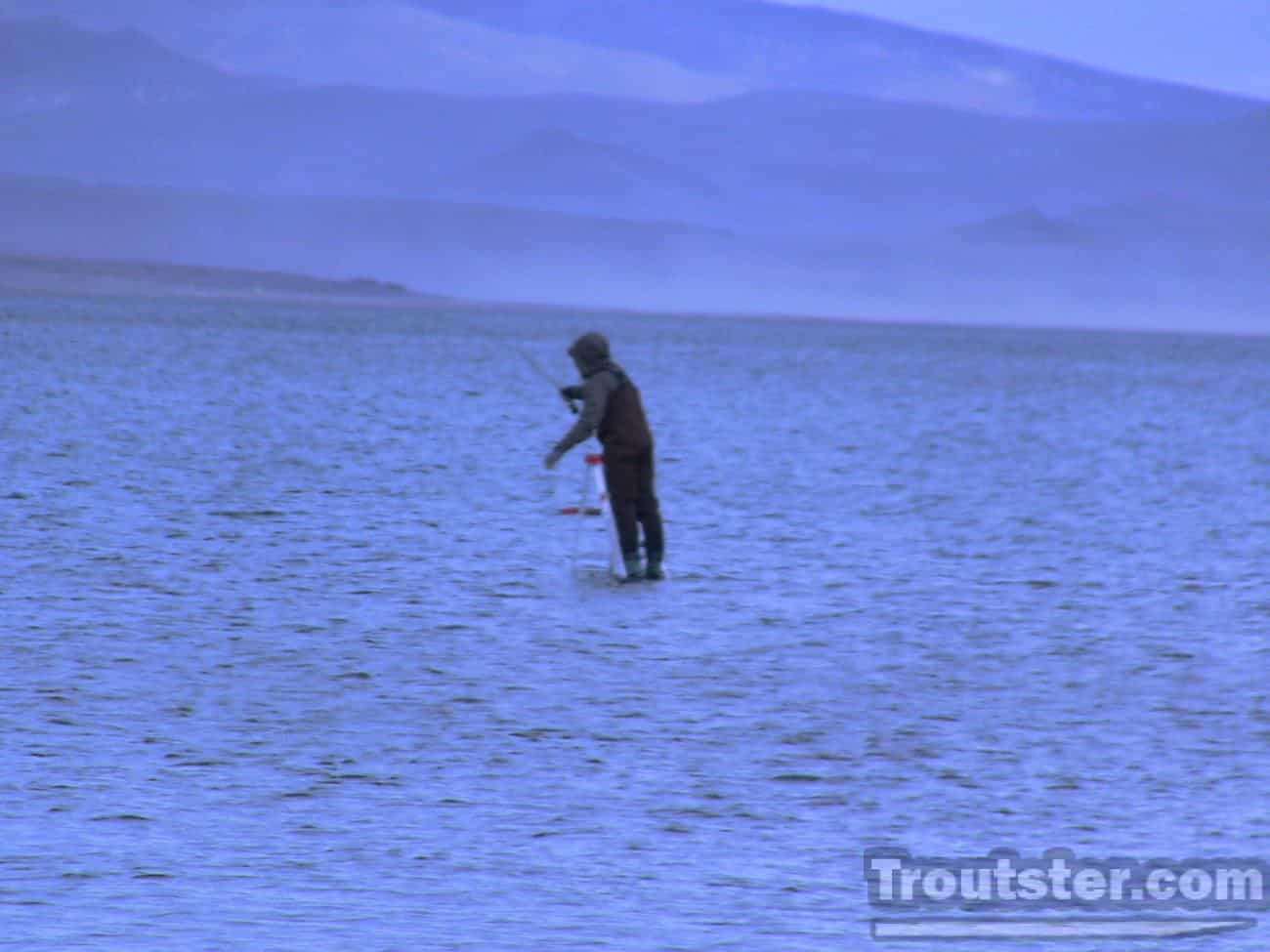 A fly fisherman casting on pyramid lake in Nevada