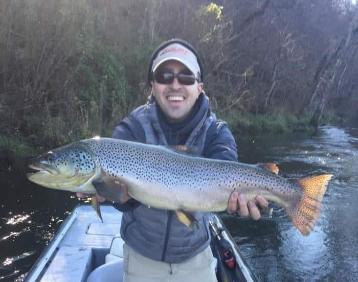 Jake jones with a 30 inch white river brown trout