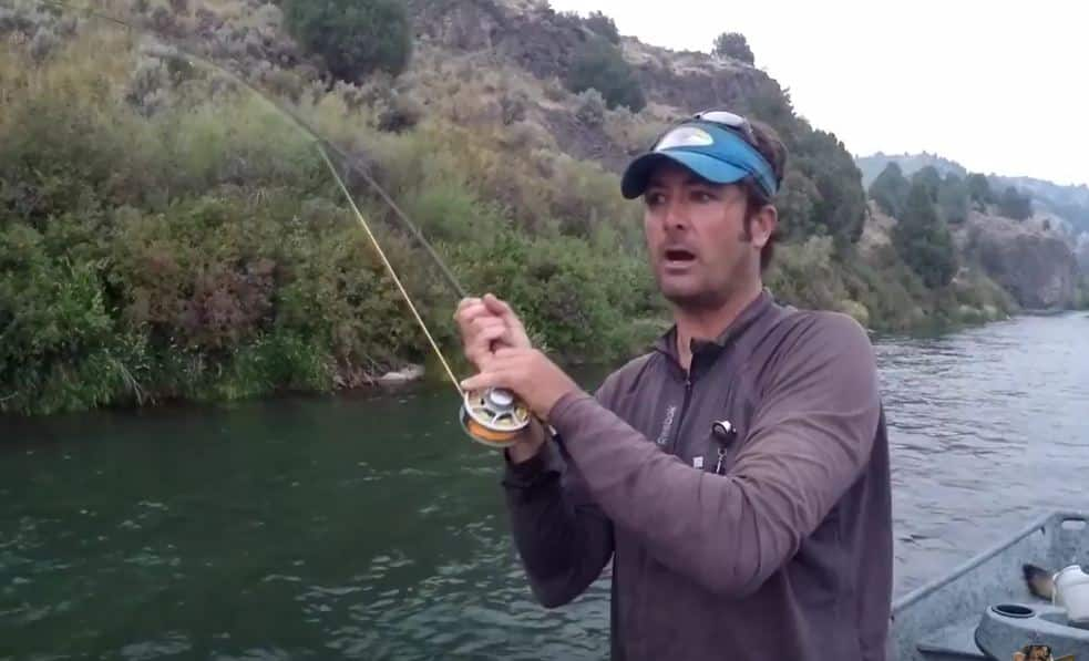 Keeping your rod upright like this is important to landing fish of all sizes