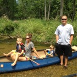 Teaching kids how to flyfish on a trout stream in Michigan