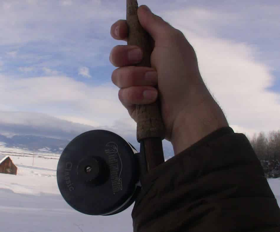 Tucking the butt of your fly fishing rod into your shirt or coat will help to fix your cast