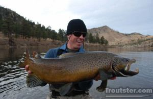 Taylor Dumont holds a huge Montana brown trout